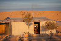 Bedouin shack in the village of Aricha next to Mitspe Ramon. Photo by Oren Nahshon