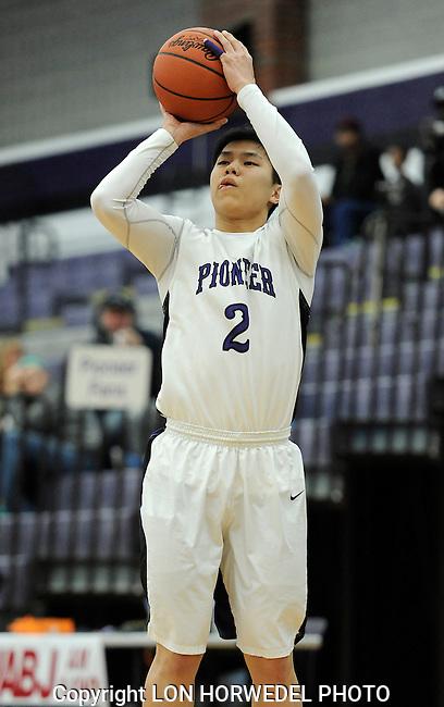 Pioneer High School varsity boy's basketball in action against Adrian High School, Wednesday, February 12, 2014, at Pioneer High School.