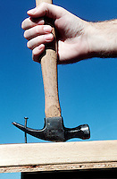 FIRST CLASS LEVER<br /> Hand with hammer pulling nail