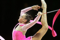 Marina Shpekt of Russia balances with ribbon during All-Around competition at 2006 Thiais Grand Prix in Paris, France on March 25, 2006.  (Photo by Tom Theobald)