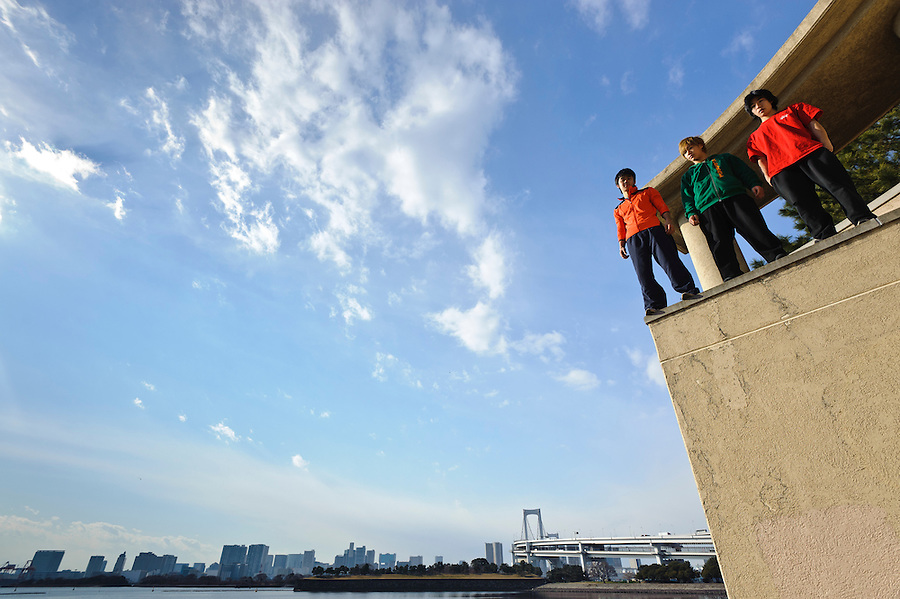 """(L to R) Traceurs (Parkour practitioners) Jun """"Sullivan"""" Sato, """"Zen"""" and """"Yutaro"""". Practicing Parkour in Odaiba, Tokyo, Japan, January 27, 2012. Parkour is a modern method of physical training, also known as freerunning. It was founded in France in the 1990s. There is a small group of around 50 parkour practitioners in Tokyo."""