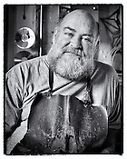 Portrait of Artist/Sculptor Jeff Rutledge, Dayton Ohio. Black & white environmental portrait in his studio