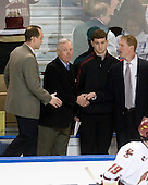 Mike Cavanaugh (BC - Associate Head Coach), Jerry York (BC - Head Coach), Stephen Greenberg (BC - Student Manager), Greg Brown (BC - Assistant Coach) - The Boston College Eagles defeated the University of Alaska-Fairbanks Nanooks 3-1 (EN) in their NCAA Northeast Regional semi-final on Saturday, March 27, 2010, at the DCU Center in Worcester, Massachusetts.