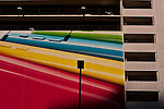 Side of parking garage building painted with a rainbow of colors downtown Seattle