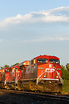 Heading west into the setting sun, a Canadian Pacific train is rolling through Adeline, IL on the IC&E/DM&E.