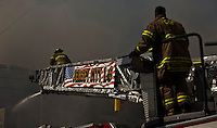 New Jersey, United States. 10th March 2013 -- NJ Firefighters attend a six-alarm fire at a New Jersey industrial building in Harrison. Photo by Eduardo Munoz Alvarez / VIEWpress.