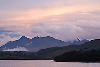 Evening light over Cuilling mountains from across Portree Bay, Isle of Skye, Scotland