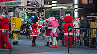 """Costumed characters swarm Times Square in New York on Friday, December 28, 2012. The """"actors"""" pose for photographs with tourists asking for tips as remuneration. Recently a number of them have been embroiled in controversy for groping women and anti-semitic ranting. Otherwise they just aggressively come up to people soliciting photos. (© Richard B. Levine)"""