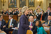 Former United States Secretary of State Hillary Rodham Clinton, a candidate for the 2016 Democratic Party nomination for President of the United States, acknowledges supporters as she arrives at the witness table prior to her testimony before the US House Select Committee on Benghazi on Capitol Hill in Washington, DC on Thursday, October 22, 2015.<br /> Credit: Ron Sachs / CNP