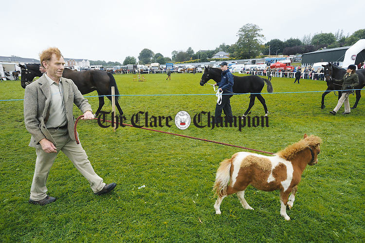Little and large.....Thomas Cunningham parades his charge at the Clare County Show in Ennis. Photograph by John Kelly.