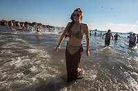 BROOKlLYN, NY - JANUARY 01 : A woman exits from the water during the annual Coney Island Polar Bear Club New Year's Day swim by running into the ocean at Coney Island , Brooklyn on January 01, 2017. Photo by VIEWpress/Maite H. Mateo.