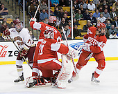 Pat Mullane (BC - 11), Max Nicastro (BU - 7), Kieran Millan (BU - 31), Sean Escobedo (BU - 21) - The Boston College Eagles defeated the Boston University Terriers 3-2 (OT) in their Beanpot opener on Monday, February 7, 2011, at TD Garden in Boston, Massachusetts.