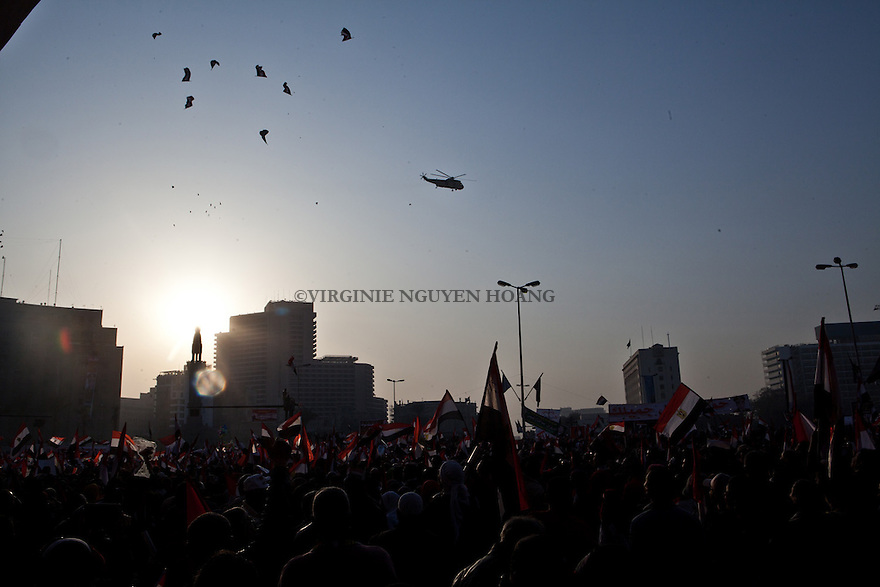 CAIRO, EGYPT - JANUARY25: Hundreds of people were celebrating the third anniversary of the Revolution on Tahrir square while chanting in support of the army and general al Sissi on 25 January 2014.  Egyptian security forces allow supporters of Abdel Fattah el-Sisi, minister of defence of Egypt, to enter the Tahrir Square, and don't allow those suspected as anti-coup demonstrators, on the 3th anniversary day of Egyptian revolution. AFP PHOTO/VIRGINIE NGUYEN HOANG
