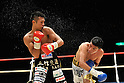 (L-R) Takashi Uchiyama (JPN), Jorge Solis (MEX), DECEMBER 31, 2011 - Boxing : Takashi Uchiyama of Japan and Jorge Solis of Mexico in action during the WBA super featherweight title bout at Yokohama Cultural Gymnasium in Kanagawa, Japan. (Photo by Hiroaki Yamaguchi/AFLO)