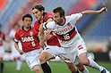 Matthew Spiranovic (Reds), Joshua Kennedy (Grampus), APRIL 24th, 2011 - Football : 2011 J.League Division 1 match between Urawa Red Diamonds 3-0 Nagoya Grampus Eight at Saitama Stadium 2002 in Saitama, Japan. The J.League resumed on Saturday 23rd April after a six week enforced break following the March 11th Tohoku Earthquake and Tsunami. All games kicked off in the daytime in order to save electricity and title favourites Kashima Antlers are still unable to use their home stadium which was damaged by the quake. Velgata Sendai, from Miyagi, which was hard hit by the tsunami came from behind for an emotional 2-1 victory away to Kawasaki. (Photo by Hitoshi Mochizuki/AFLO).