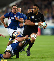 Victor Vito of New Zealand looks to offload the ball after being tackled. Rugby World Cup Pool C match between New Zealand and Namibia on September 24, 2015 at The Stadium, Queen Elizabeth Olympic Park in London, England. Photo by: Patrick Khachfe / Onside Images
