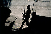 Sukhumi, Abkhazia<br /> September 27, 1993<br /> <br /> From behind a school house, advancing Abkhazian separatists prepare to attack Georgian forces that were held up inside the Parliament. Within hours the Abkhazians would control the Parliament building and the city.