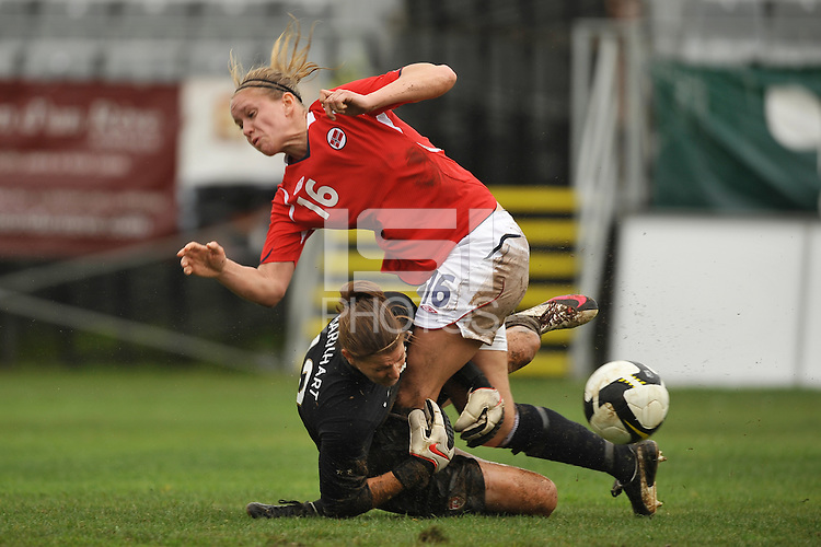 Nicole Barnhart collides with Norway #16 during an Algarve Cup match in March 2010.