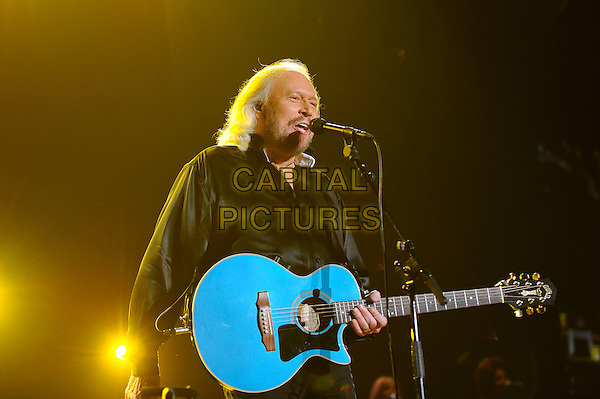 Barry Gibb <br /> performing in concert on the first date of the UK 'Mythology' Tour, LG Arena, Birmingham, England, UK, 21st September 2013.<br /> music live on stage gig half length black shirt silk singing microphone playing guitar <br /> CAP/MAR<br /> &copy; Martin Harris/Capital Pictures