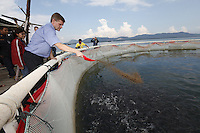 Visiting a fish farming project. Minister of the Environment and International Development, Erik Solheim, during a visit to Khao Lak, north of Phuket. The area was severley hit by the Tsunami that struck Asia 26/12/2004.The area has since been rebuilt, and tourists have returned.  .&copy;Fredrik Naumann/Felix Features.