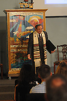 NWA Democrat-Gazette/FLIP PUTTHOFF <br /> YOM KIPPUR<br /> Rabbi Rob Lennick addresses the congregation on Wednesday Sept. 23 during a Yom Kippur service at Waterway Christian Church in Bentonville. Yom Kippur is a solemn day of fast in the Jewish faith. It is the last and most important of Judaism's 10 High Holy Days.