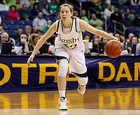 SOUTH BEND, IN - FEBRUARY 11: Madison Cable #22 of the Notre Dame Fighting Irish dribbles the ball up court during the game against the Louisville Cardinals at Purcel Pavilion on February 11, 2013 in South Bend, Indiana. Notre Dame defeated Louisville 93-64. (Photo by Michael Hickey/Getty Images) *** Local Caption *** Madison Cable
