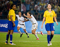 USWNT midfielder (11) Carli Lloyd celebrates her game-winning goal with teammate (16) Angela Hucles while playing for the gold medal at Workers' Stadium.  The USWNT defeated Brazil, 1-0, during the 2008 Beijing Olympic final in Beijing, China.
