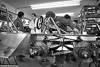 OCKHAM, SURREY - MAY, 1976: Derek Gardner, designer of the Tyrrell P34 six-wheel Formula 1 car, discusses the car with a crew member at the Tyrrell Racing Organization headquarters in Ockham, Surrey, United Kingdom.