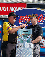 Sep 3, 2016; Clermont, IN, USA; NHRA announcer Alan Reinhart (left) talks with NHRA president Peter Clifford during qualifying for the US Nationals at Lucas Oil Raceway. Mandatory Credit: Mark J. Rebilas-USA TODAY Sports