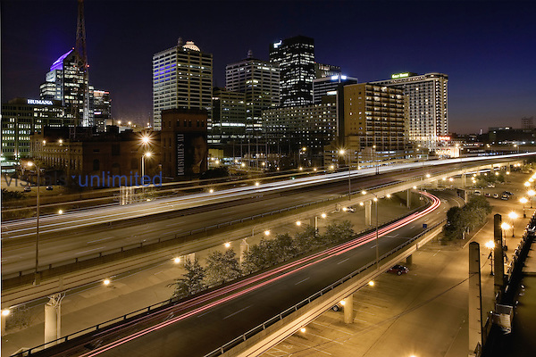 Time exposure of traffic on I64/I71 passing in front of Louisville skyline, Louisville, KY.