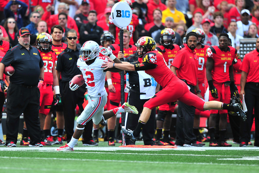 Buckeyes' Dontre Wilson is pushed out of bounds by Terrapins' punter Nathan Renfro.  Ohio State trounced Maryland 52-24 during a game at the Capital One Field in Byrd Stadium, College Park, MD on Saturday, October 4, 2014.  Alan P. Santos/DC Sports Box