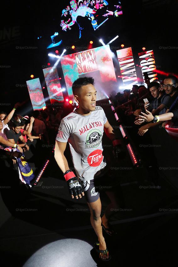 Keanu Subba, MIMMA Featherweight Champion, enters the stadium<br /><br />MMA. Mixed Martial Arts &quot;Tigers of Asia&quot; cage fighting competition. Top professional male and female fighters from across Asia, Russia, Australia, Malaysia, Japan and the Philippines come together to fight. This tournament takes place in front of a ten thousand strong crowd of supporters in Pelaing Stadium. Kuala Lumpur, Malaysia. October 2015