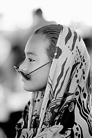 Republic of Nauru. Central Pacific. Nauru is a tiny island (21 square-km). A young beautiful girl and her glasses at the celebration of Kayser College's 50 years teaching to island's students. Kayser College is a catholic school. © 1999 Didier Ruef