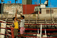 Cuban boys play in the boxing ring at Rafael Trejo boxing gym in Havana, Cuba, 13 February 2010. During the last 30 years Cuba has produced more World Champions and Olympic gold medallists in amateur boxing than any other country. Many famous fighters, who came out of Cuba, were training at Rafael Trejo boxing gym in their youth. This run down open air facility in the Old Havana is a place of learning and mastering the art of boxing by the old school style. Boys begin their training very young. As sports are given a high political priority in Cuba, all children are systematically encouraged to develop their skills. Those who succeed will become heroes of Cuban society.