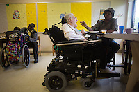 Caretakers help Fernald resident Margaret Rouleau eat lunch at the Fernald Developmental Center in Waltham, Mass., USA.