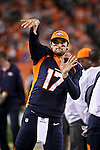 SHOT 10/19/14 7:55:03 PM - Denver Broncos quarterback Brock Osweiler #17 warms up on the sidelines in the fourth quarter against the San Francisco 49ers at Sports Authority Field at Mile High Sunday October 19, 2014 in Denver, Co. The Broncos beat the 49ers 42-17. (Photo by Marc Piscotty / © 2014)