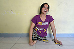 In Abucay, a seaside town in the Philippines province of Bataan, Ellen Bundang laughs as she sits on the floor of her home. Born with abnormal legs, she is a member of the local Persons with Disabilities (PWD) organization.