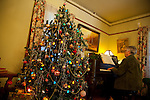 A volunteer plays holiday melodies on the piano as visitors toured te J. Gilbert Smith House in Los Altos during a Holiday Open House Nov. 14.