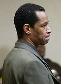 Sniper suspect John Allen Muhammad stands as the judge enters the court after a break in his trial in the Virginia Beach Circuit Court in Virginia Beach, Virginia on November 12, 2003.  <br /> Credit: Lawrence Jackson - Pool via CNP