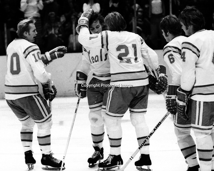 Seals goal, Dave Hrechkosy is congratulated by teammates Stan Gilbertson, and Stan Weir, Bob Stewart and Len Frig. (1974 photo/Ron Riesterer)