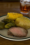 Grilled shoulder roast dinner with steamed corn, cabbage and brussels.. Jim Bryant Photo. ©2010. All Rights Reserved.