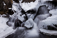 Crystals of ice form a diamond-studded waterfall along Andrews Creek in Rocky Mountain National Park, Colorado.