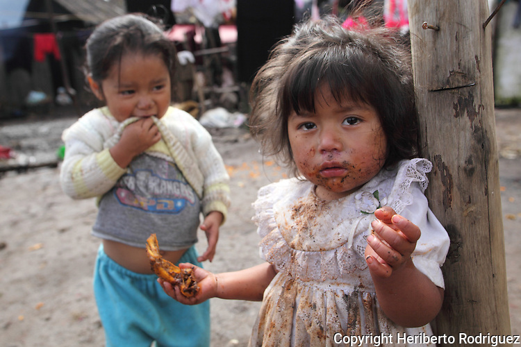 Two poor Native nahuatl children play around in their backyard in their village of San Francisco Atotonilco, in northern state of Hidalgo, during the festivities of the Day of the Deads. Hundreds of Native villages pay homage to their deads on the eve of November 2 as a tradition since the preHispanic times. Photo by Heriberto Rodriguez