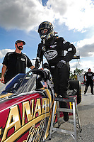 Jan. 17, 2012; Jupiter, FL, USA: NHRA top fuel dragster driver Khalid Albalooshi  uses a step ladder to climb into his car during testing at the PRO Winter Warmup at Palm Beach International Raceway. Mandatory Credit: Mark J. Rebilas-