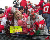 "Ohio State fans ""Buckeye man"" and ""Bucknut"". The Ohio State Buckeyes defeated the Purdue Boilermakers 56-0 at Ross-Ade Stadium, West Lafayette, Indiana on November2, 2013."
