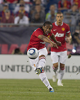 Manchester United FC midfielder Anderson (8) passes the ball. In a Herbalife World Football Challenge 2011 friendly match, Manchester United FC defeated the New England Revolution, 4-1, at Gillette Stadium on July 13, 2011.