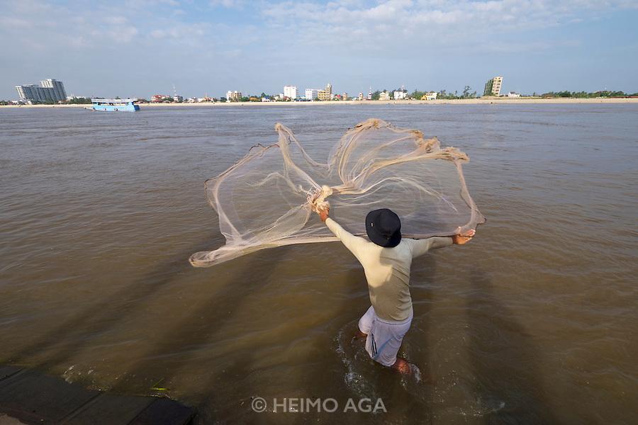 Phnom Penh, Cambodia. Net fishing at Tonle Sap.