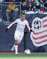 New England Revolution midfielder Scott Caldwell (6) dribbles.  In a Major League Soccer (MLS) match, Sporting Kansas City (blue) tied the New England Revolution (white), 0-0, at Gillette Stadium on March 23, 2013.