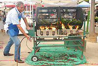 Pico Farmers Market Manager Ted Galvan roasts peppers and corn on the cob on Saturday, September 3, 2011.