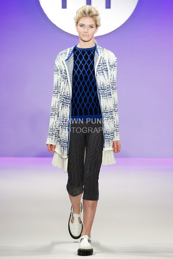 Model walks runway in an outfit by Melissa Ngo, during the FIT Future of Fashion 2014 Graduates' Collection fashion show, at the Fashion Institute of Technology on May 1, 2014.